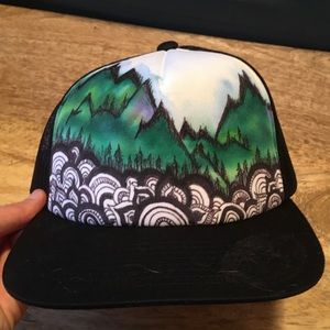 Hand-painted mountain trucker hat